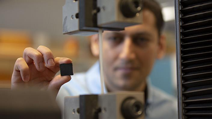 UBCO School of Engineering researcher Mohammad Arjmand examines the new polymer-based brake pad, which he says could revolutionise braking systems in cars and trains (Credit: UBC Okanagan)