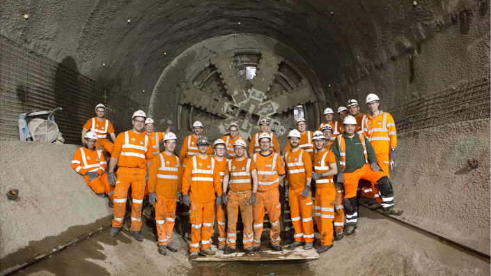 Workers stand in a Crossrail tunnel (Credit: Crossrail)