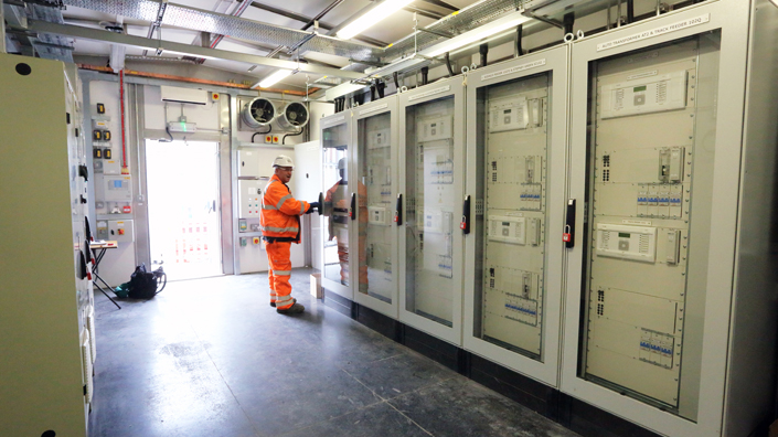 An engineer inspects a Crossrail control room (Credit: Crossrail)