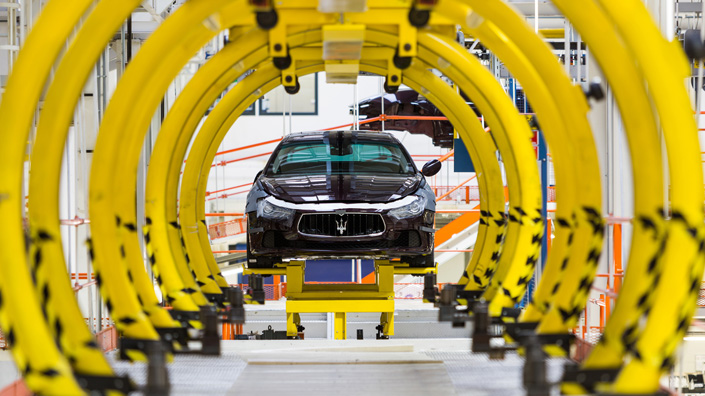 Maserati Ghibli luxury cars move along the semi-automated production line at Fiat SpA's Grugliasco 'digital' factory in Turin, Italy