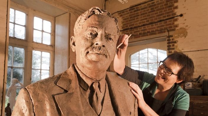 Sculptor Hazel Reeves working on Sir Nigel Gresley statue - photo by Roger Bamber