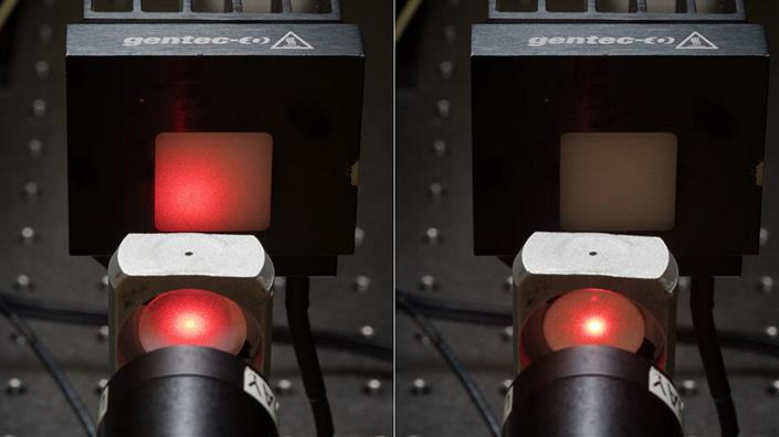 Optical transmission through a transparent ceramic (left) vs. a traditional opaque ceramic (right). (Credit: David Baillot/UC San Diego Jacobs School of Engineering)