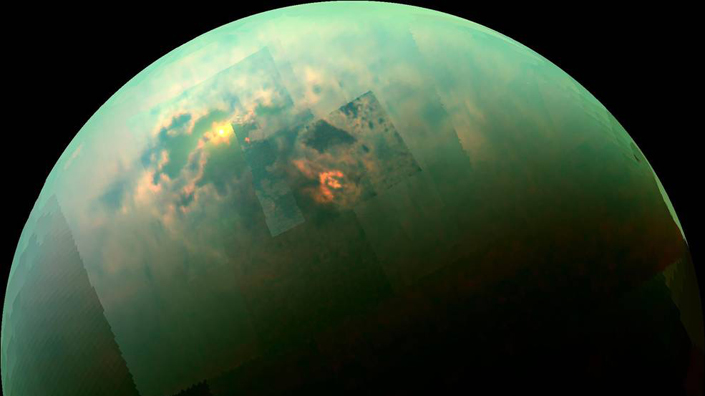 (Sunlight glints off of Titan's northern seas in this near-infrared, colour mosaic from Cassini. Credit: NASA)
