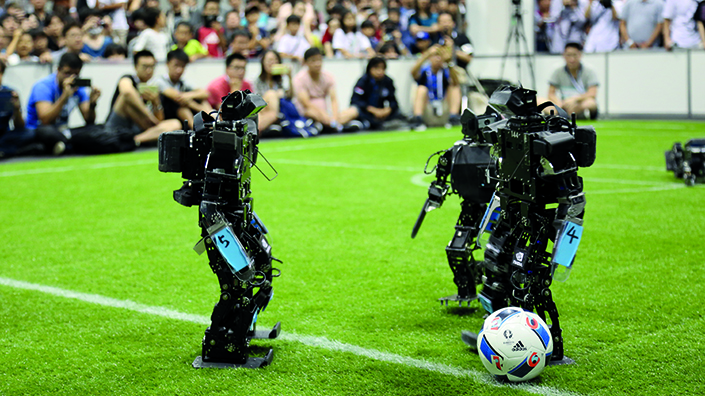 Kid-size humanoid robots try not to fall over (and play football) (Credit: RoboCup)