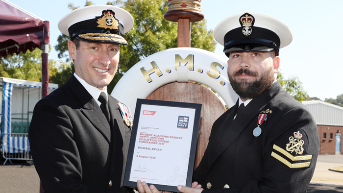 PO Michael Bevan receiving award from Rear Admiral Paul Methven